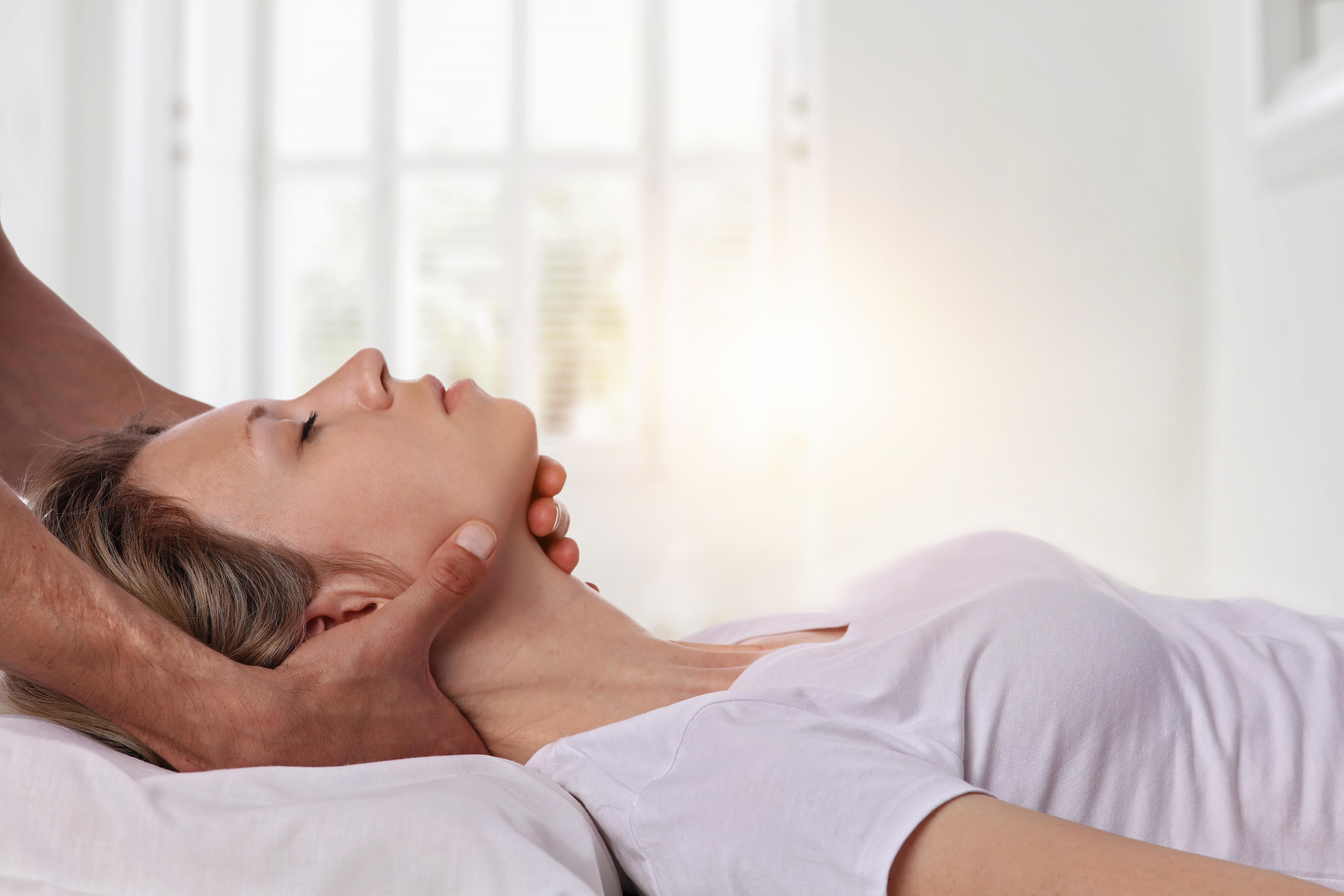 Woman getting chiropractic wellness care